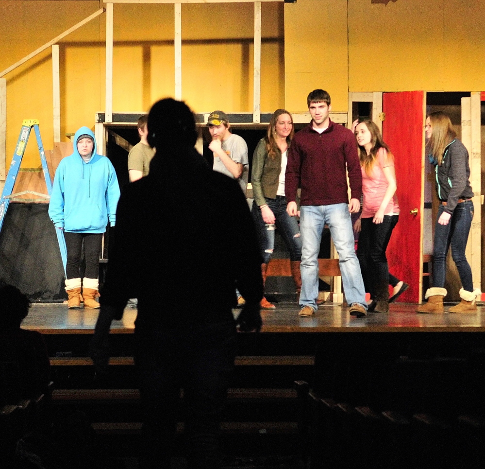 "Under the Bard walk: A student makes an entrance down the center of the stage Friday during rehearsal of a scene from ""Romeo and Juliet"" for Lit Fest in the Little Theater at Gardiner Area High School in Gardiner."