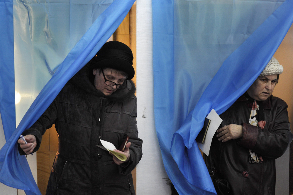 Women exit polling booths during the Crimean referendum in Sevastopol, Ukraine, on Sunday.