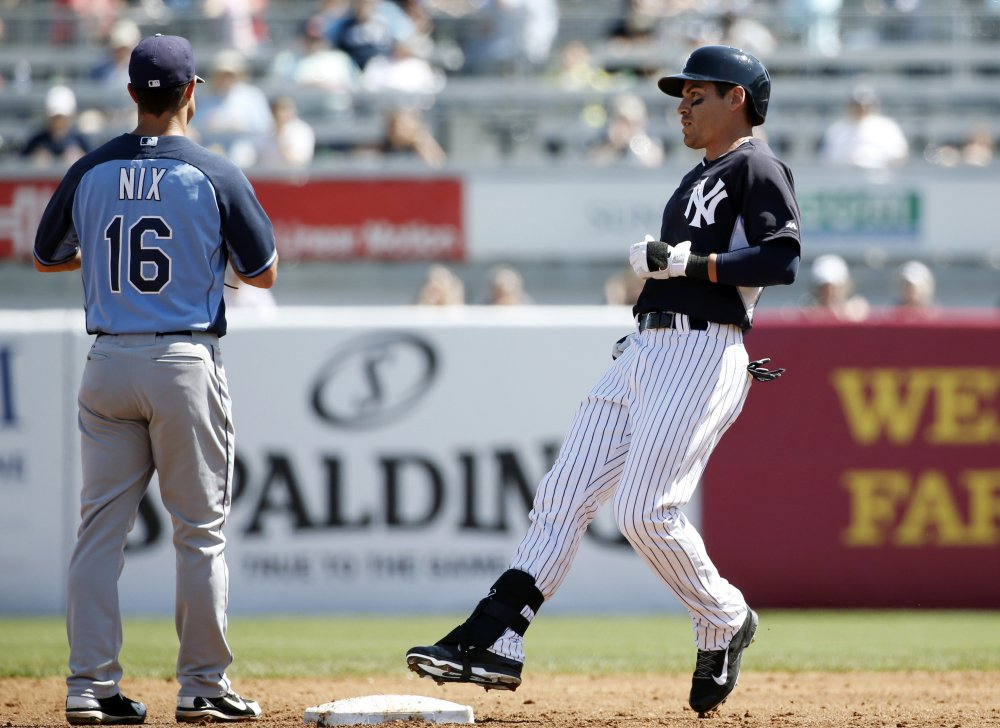 New York Yankees center fielder Jacoby Ellsbury missed Sunday's exhibition game against Atlanta with a tight right calf.
