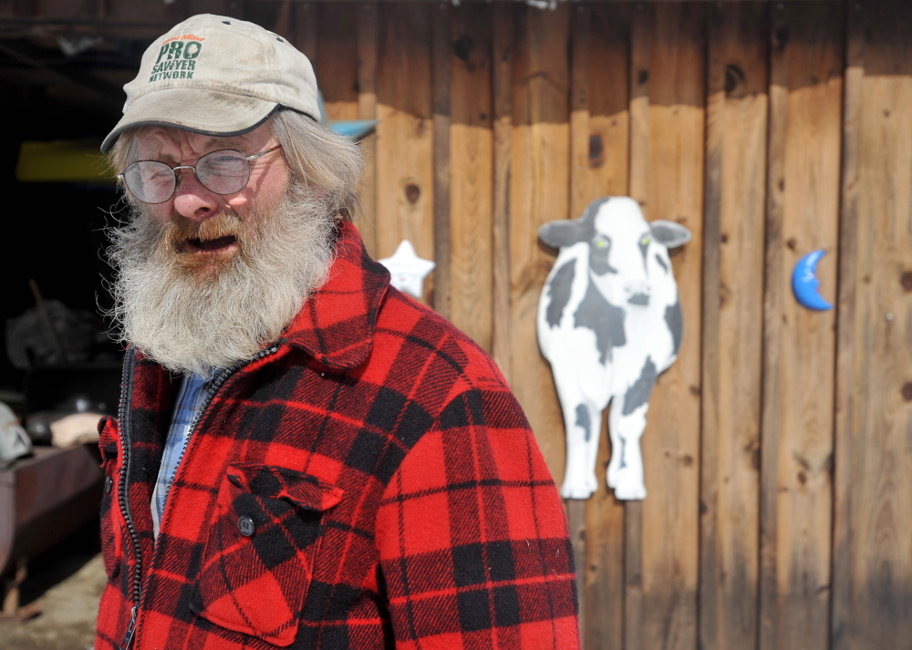 Part of the package: Along with chickens, Dan Charles raises cattle and goats at his small farm in Mercer.