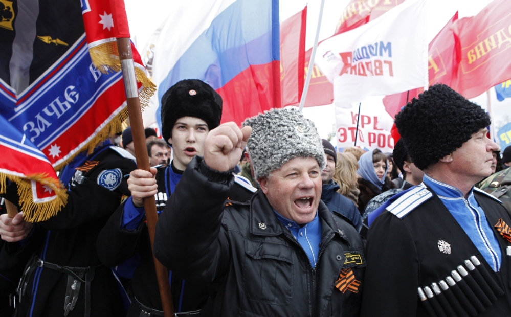 While Ukrainians struggle to come to grips with an uncertain political landscape, many of their former countrymen in Crimea are celebrating. Here, a group of Cossacks attend a rally to support the annexation of Ukraine's Crimea to Russia in the southern Russian city of Stavropol on Tuesday. Tensions remain high in the region after a military attack Tuesday.