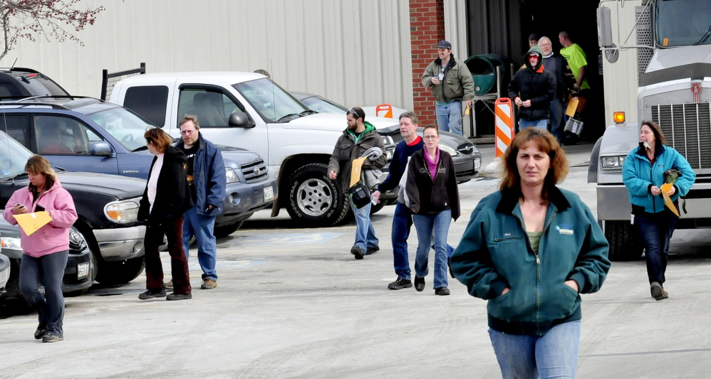 HEADING HOME: Employees leave United Technologies Corp. Fire & Security company in Pittsfield exit on Wednesday. The company announced Tuesday it will close in a year. Employees interviewed Wednesday said that they did not see the announcement coming and the mood of workers was subdued.