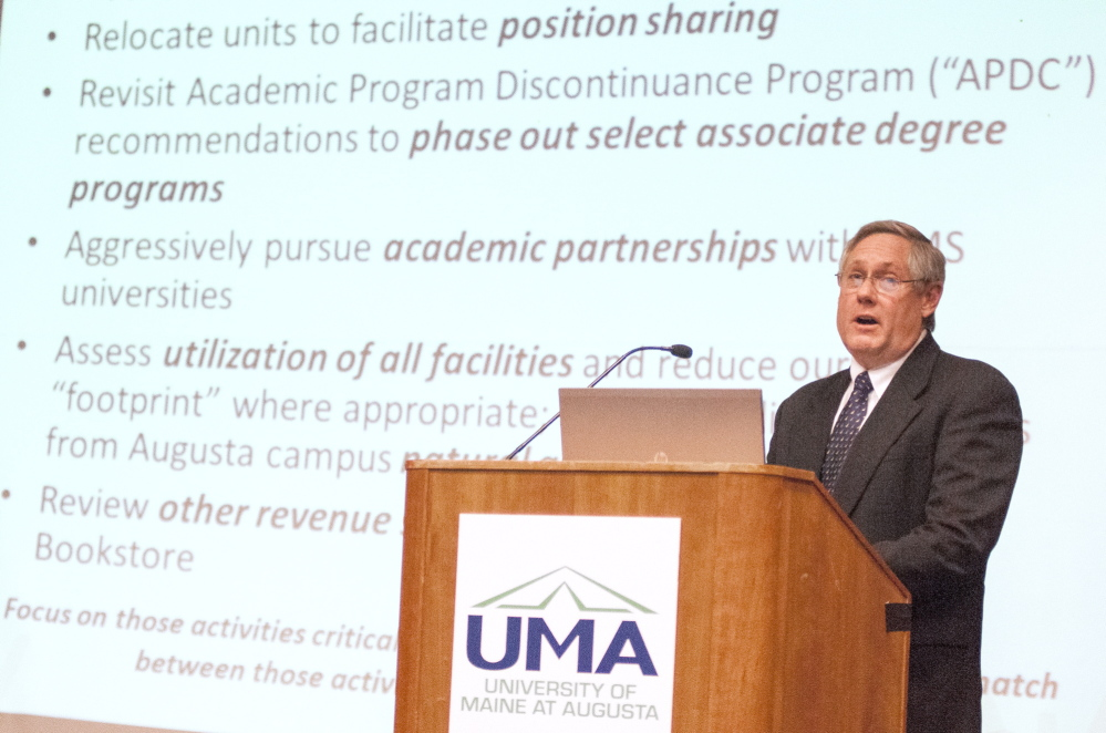 UMA cuts: Tim Brokaw, vice president of finance and administration, gives a presentation on proposed budget cuts during a meeting on Wednesday in Jewett Hall at the University of Maine at Augusta.
