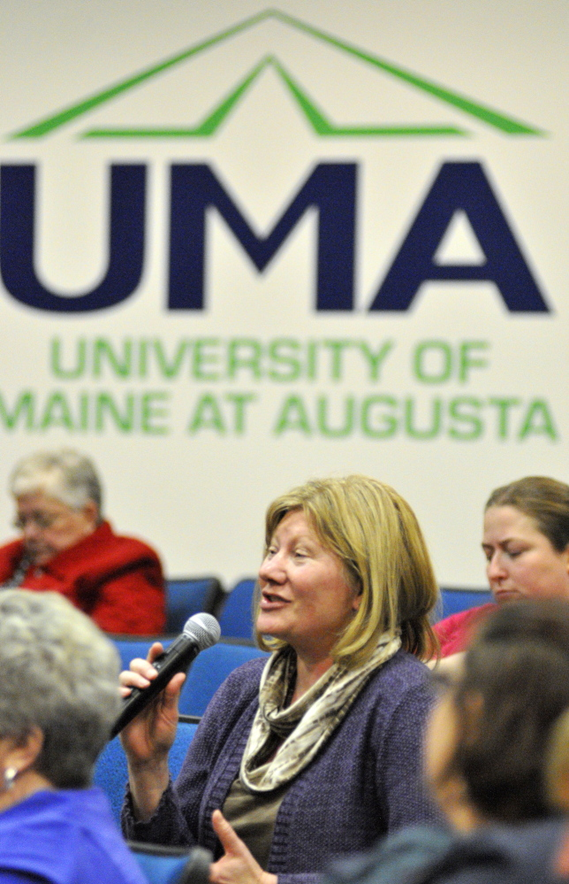 UMA cuts: Anita Jerosch, who works in the music program, asks a question about proposed budget cuts during a meeting on Wednesday in Jewett Hall at the University of Maine at Augusta.