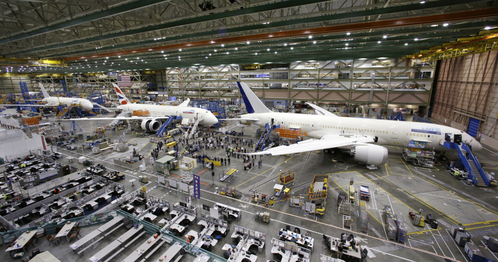 A line of Boeing 787 jets sits on the floor nearing completion at the company's production plant in Everett, Wash., in May 2013.