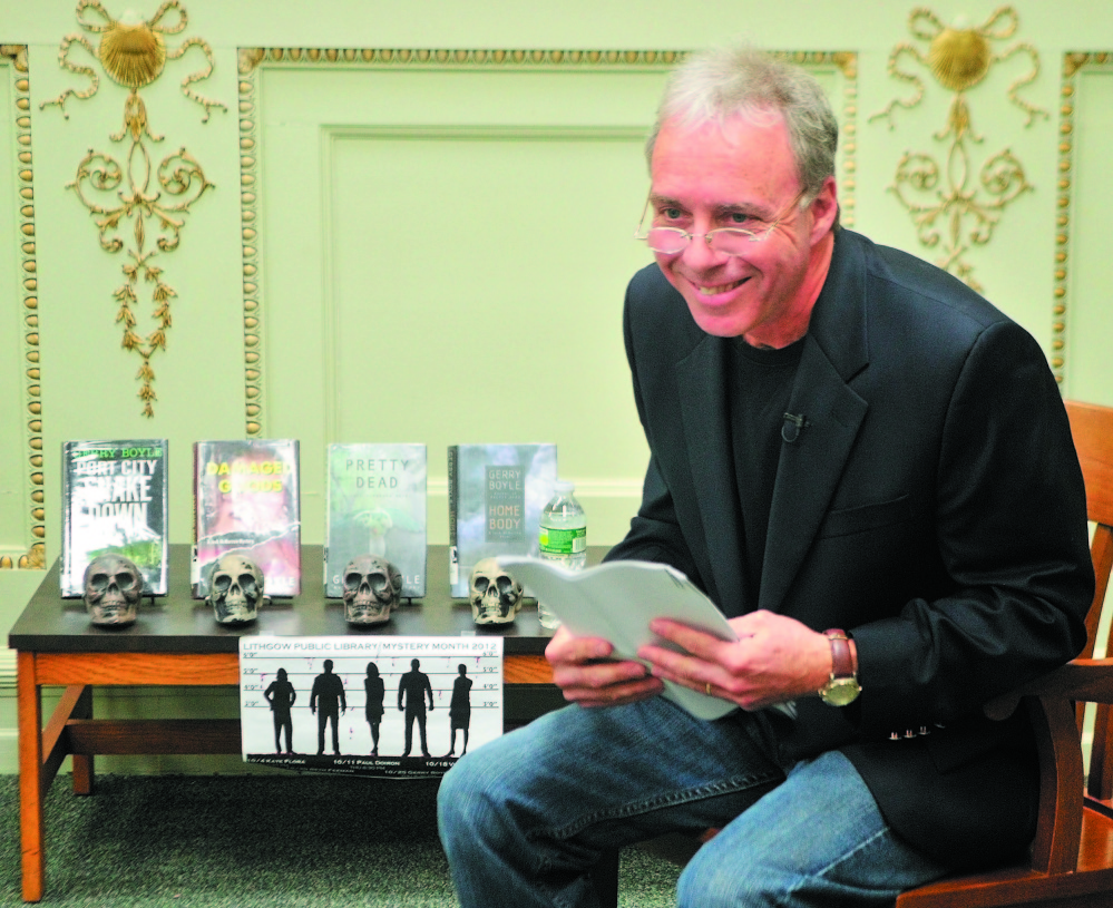 Staff file photo by Joe Phelan RIDING THE CRIME WAVE: Central Maine crime fiction writer Gerry Boyle, seen here reading to an audience at Augusta's Lithgow Library in 2012, will be one of a number of mystery writers who live in the state featured at the April 19 Crime Wave conference in Portland, sponsored by the Maine Writers and Publishers Alliance.