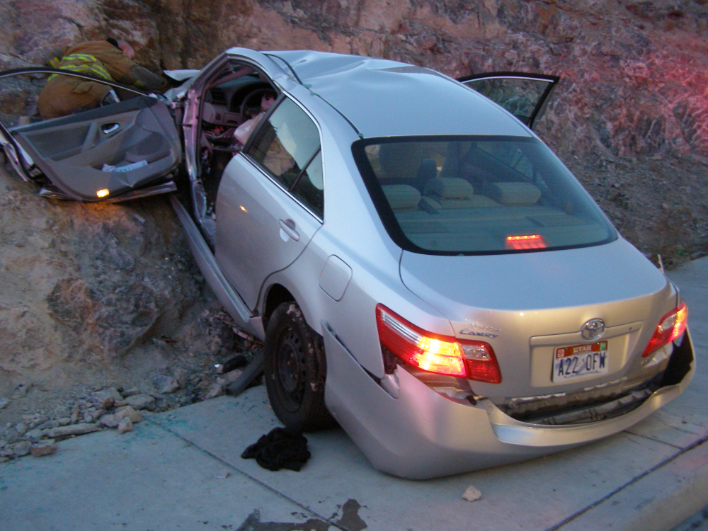 A Toyota Camry is shown after it crashed as it exited Interstate 80 in Wendover, Utah, in this Nov. 5, 2010, photo released by the Utah Highway Patrol. Police suspected problems with the Camry's accelerator or floor mat caused the crash that left two people dead and two others injured.
