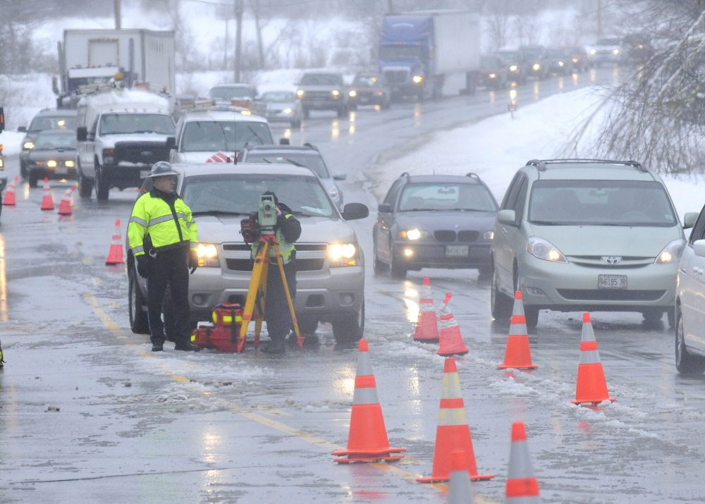 morning accident: Police reconstruct a two-car accident that claimed the life of a man and injured a woman on Route 202 in Winthrop.