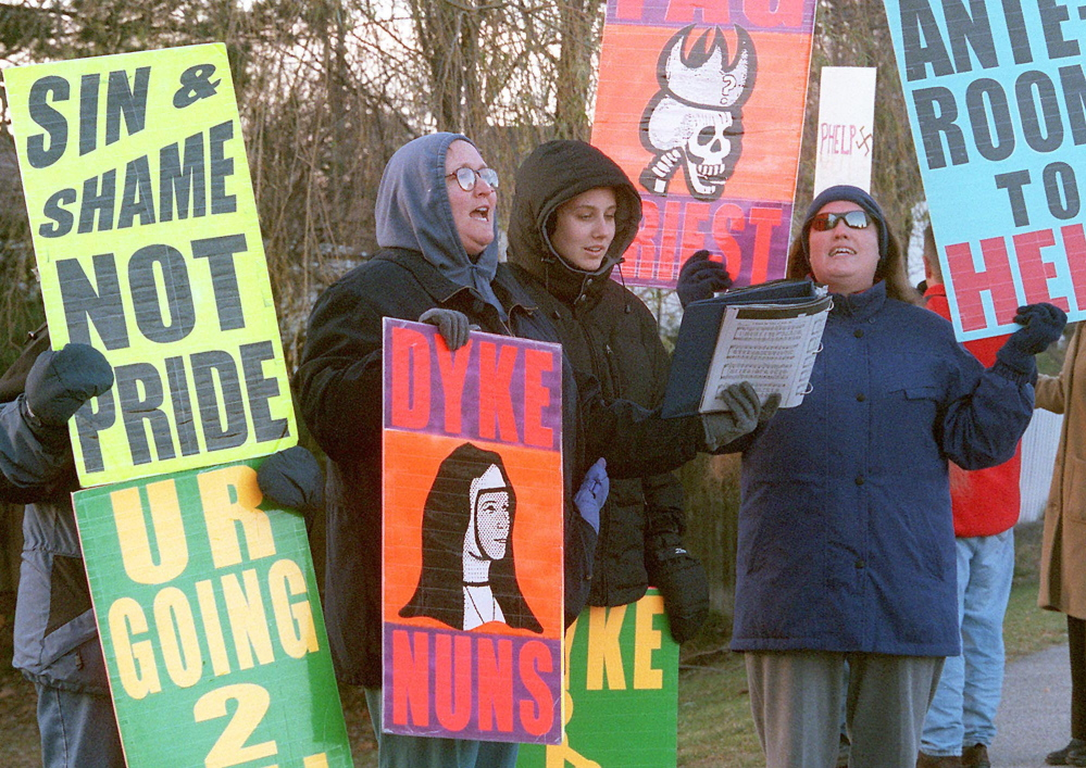 Parishioners from the Westboro Baptist Church of Topeka, Kan., sing hymns while picketing St. Andrews Presbyterian Church in Kennebunk on a Sunday morning in November 2000. They said they were protesting Question 6, the proposed gay rights law that voters rejected on Election Day that year.