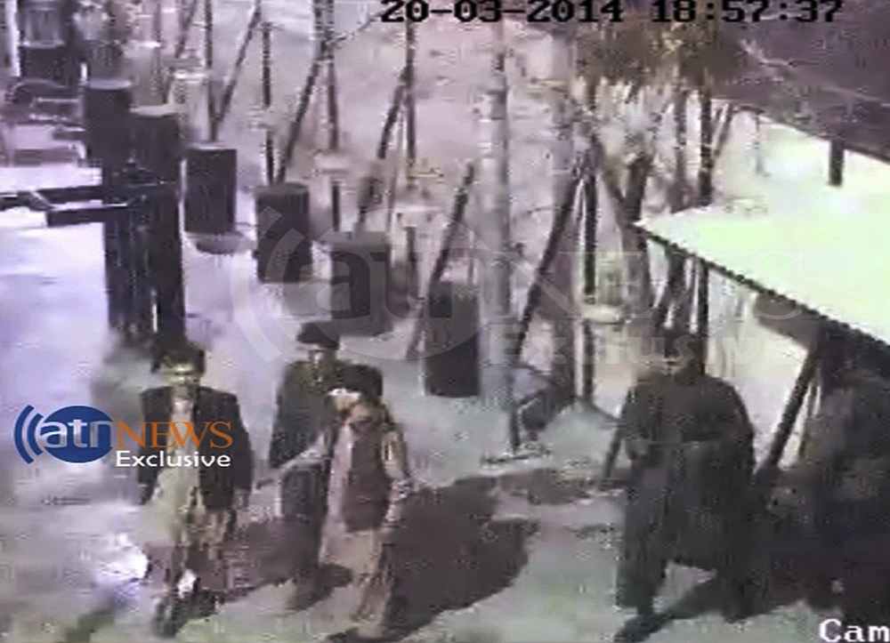 In this frame grab provided from a video by Ariana Television News, four attackers entering the first gate of the Serena hotel in Kabul, Afghanistan on Thursday.