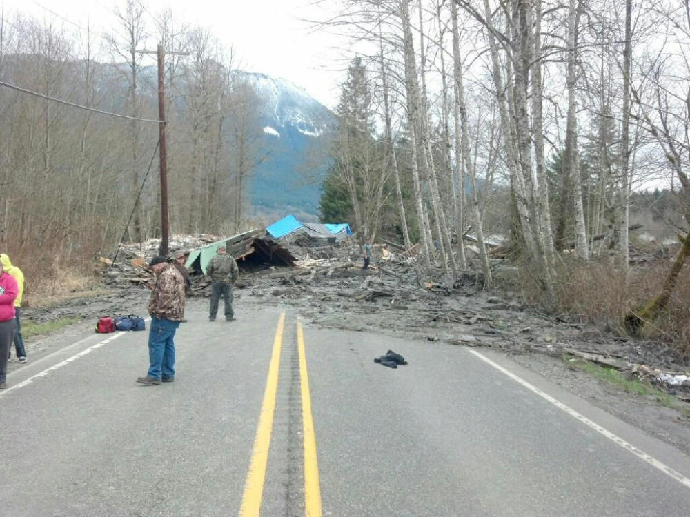 This photo provided by the Washington State Patrol shows the aftermath of a mudslide that moved a house with people inside in Snohomish County on Saturday.