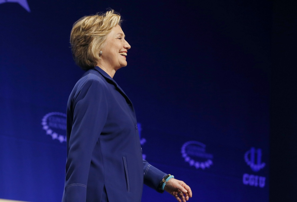 Former Secretary of State Hillary Rodham Clinton smiles as she walks on stage to give an address at a student conference for the Clinton Global Initiative University at Arizona State University on Friday in Tempe, Ariz.