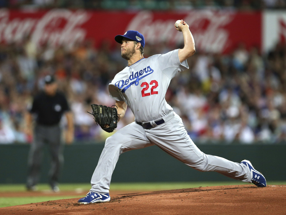 Clayton Kershaw of the Dodgers throws his first pitch of the 2014 season against the Arizona Diamondbacks at the Sydney Cricket ground in Sydney, on Saturday.
