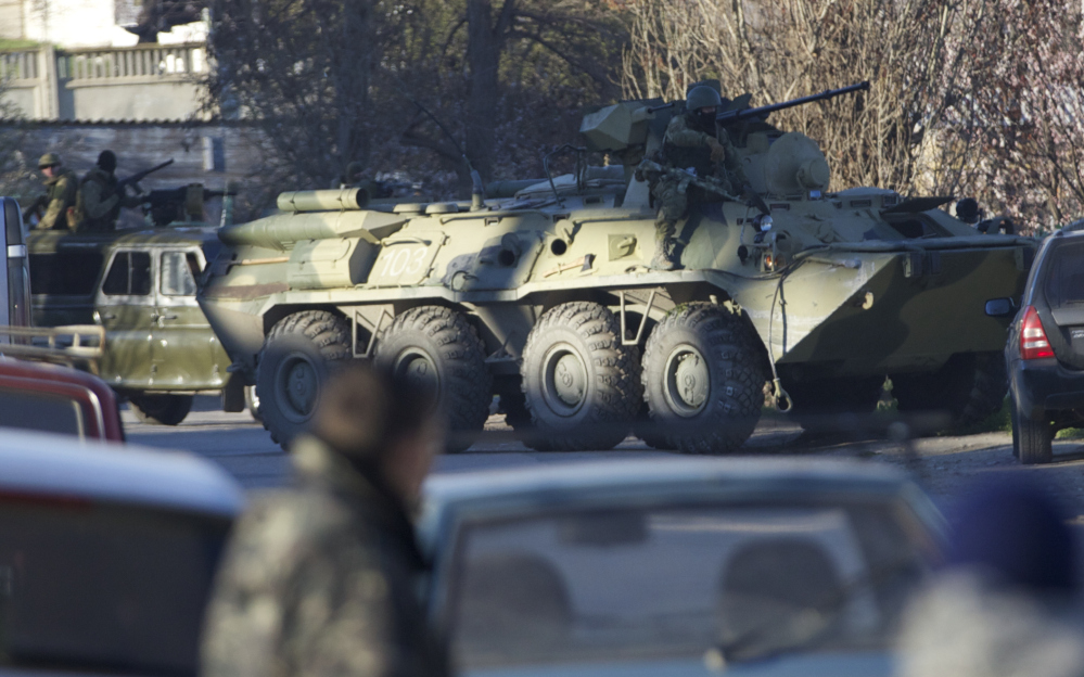 A Russian APC breaks into the fence of the Belbek airbase gate after Russian troops took control, outside Sevastopol, Crimea, on Saturday. Russian forces used at least four armored vehicles to break into an air base here, seizing control of one of the last Ukrainian military outposts in Crimea.