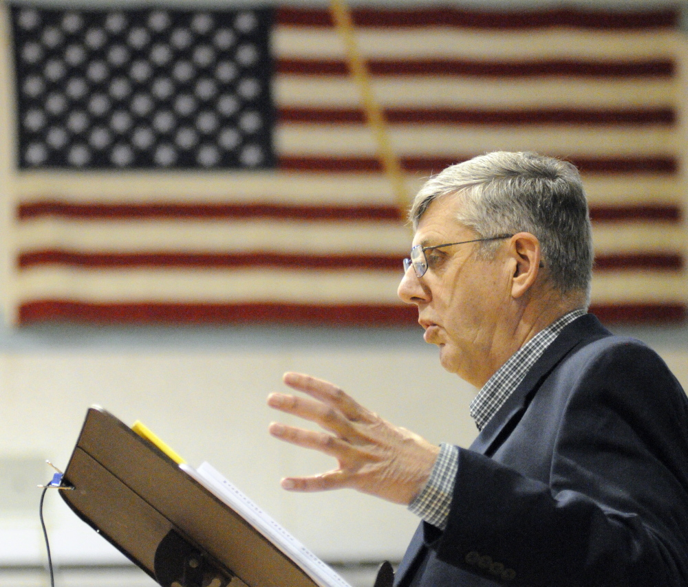 Moderator: Selectman Donald Grinnell answers a resident's question during debate about cemetery maintenance during Washington's Town Meeting on Saturday in Prescott Memorial School in Washington.