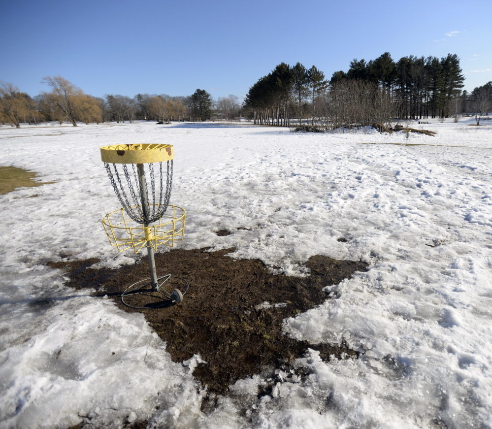 """Pleasant Hill Disc Golf in Scarborough was still snow-covered Monday. Owner Kristi Stanley says she doesn't know when it will open. """"I'm tired of guessing,"""" she said."""