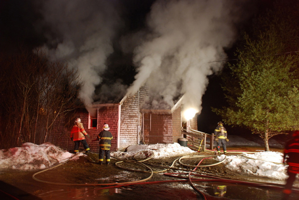 ON THE SCENE: Fire departments from Franklin County towns Chesterville, Farmington, Industry, New Sharon, Strong, Temple and Wilton all responded to this structure fire in March 2013. Franklin County's fire departments are struggling to attract new volunteers and are considering a regional solution.