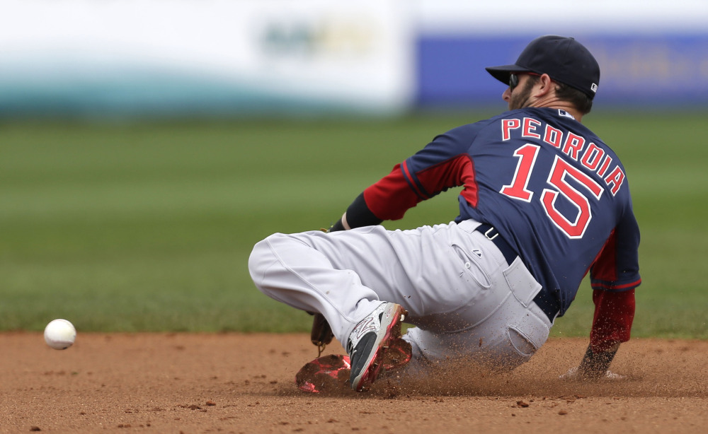 Boston Red Sox second baseman Dustin Pedroia (15) chases after a line drive by Tampa Bay Rays' James Loney in the second inning of an exhibition baseball game in Port Charlotte, Fla., Tuesday, March 25, 2014.