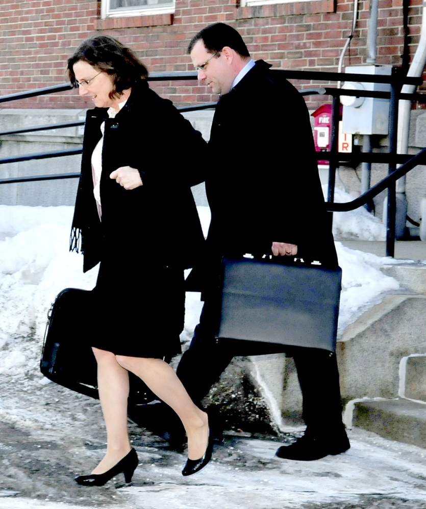 DEFENSE: Attorney John Martin and a colleague leave Skowhegan District Court on Thursday after a hearing on the competence on his client Kelli Murphy, 12, charged in the death of 3-month-old Brooklyn Foss-Greenaway.