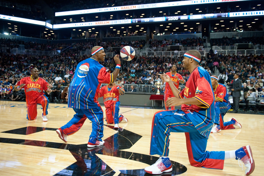 THEY'RE BACK: Members of the Harlem Globetrotters, including guard Dizzy Grant, left, warm up before a game earlier this season. The Globetrotters will be at the Augusta Civic Center on Monday night.