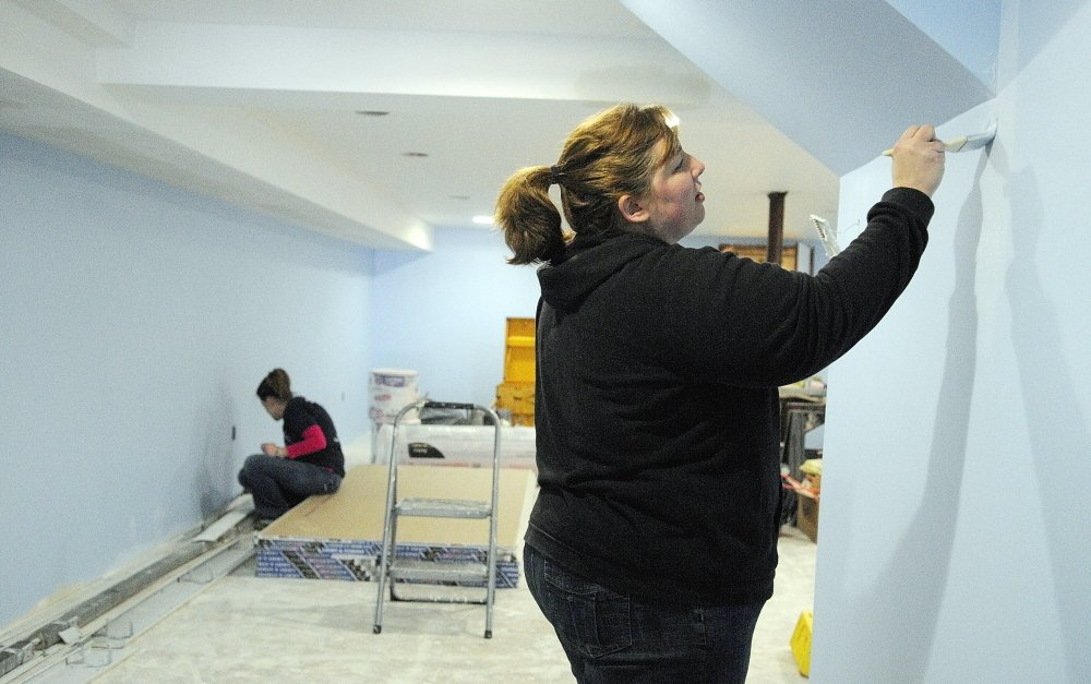 ANOTHER COAT, ANOTHER PURPOSE: Melanie Miller, left, and Kiley Perry paint walls in the nursery Wednesday at the new Kennebec Community Church in Augusta. The group recently bought the former St. Andrew Church building off South Belfast Avenue, on the east side of Augusta.