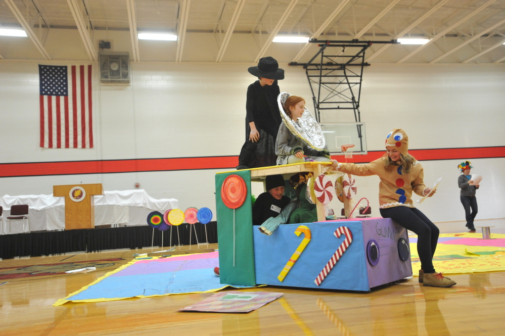 Showing their drive: Students from the Mast Landing School in Freeport negotiate the Driver's Test course Saturday in the state competition of Maine Odyssey of the Mind at Thomas College in Waterville. More than 30 schools from all over Maine competed in the creative problem solving games.