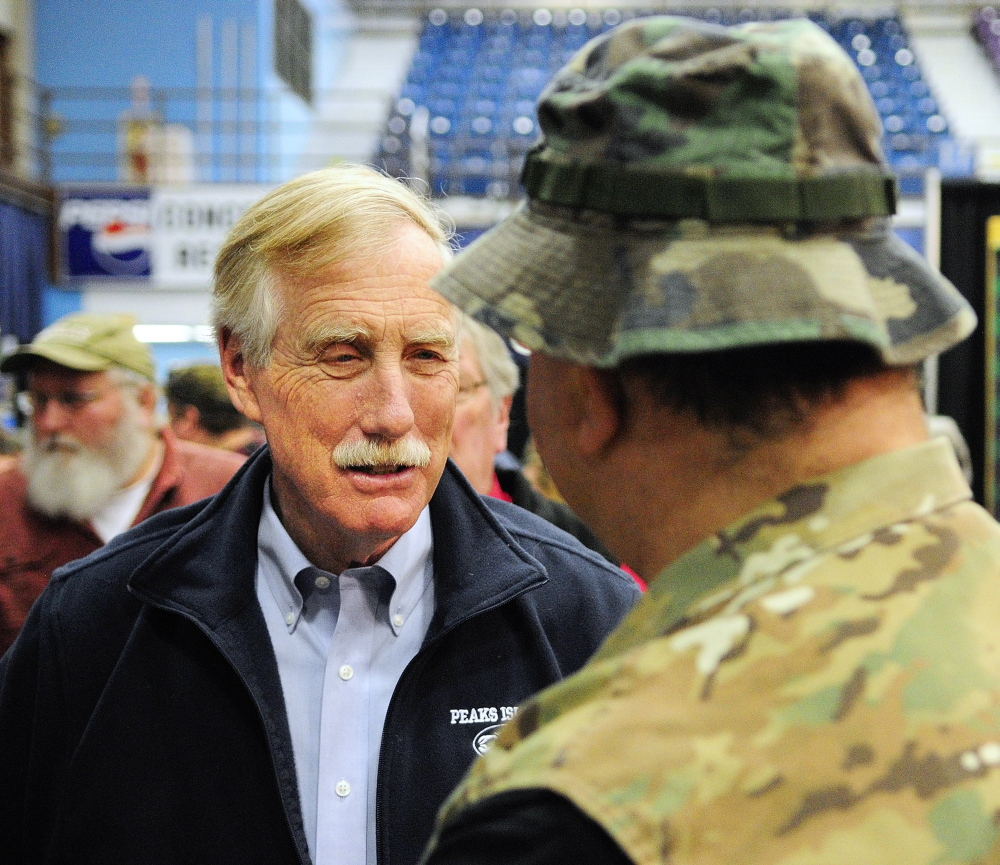 Undecided: Sen. Angus King chats with a showgoer Saturday at the Maine Sportsmans Show in the Augusta Civic Center.
