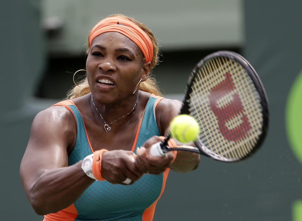 Serena Williams returns to Li Na during the women's final at the Sony Open Tennis tournament in Key Biscayne, Fla., on Saturday. Williams won her seventh Key Biscayne title, 7-5, 6-1.