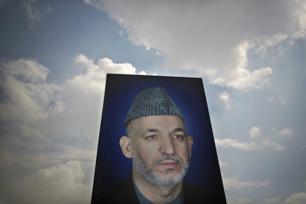 The Associated Press In this Saturday, March 29, 2014 photo, a giant picture of Afghan President Hamid Karzai is displayed on the parade ground of the Ministry of Defense in Kabul, Afghanistan.