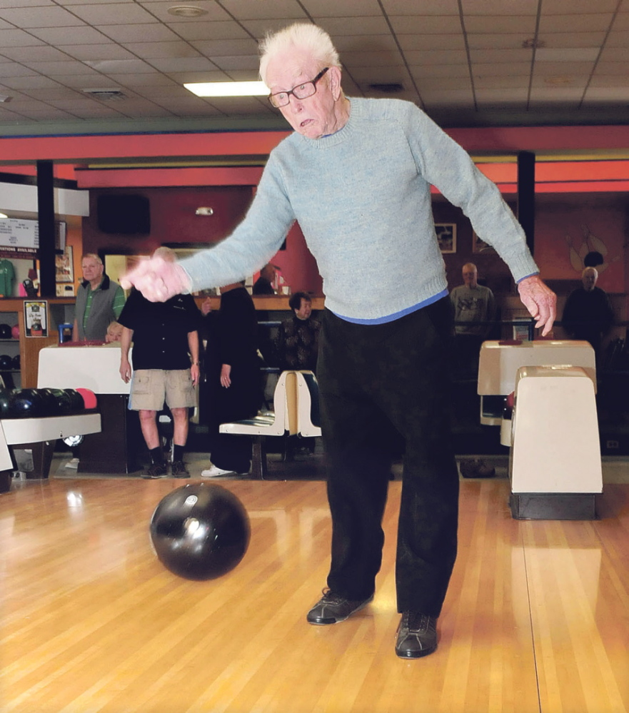 Staff photo by David Leaming STILL ROLLING: Red Ryer, 98, still actively bowls with the Primetimes league at the Sparetime Bowling Center in Waterville on Monday, March 24, 2014.