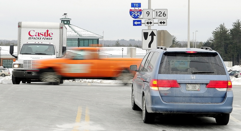 HAZARDOUS SITE: Drivers entering and leaving the West Gardiner Service Plaza wait for a break in traffic in February on Routes 9 and 126 in West Gardiner. The Maine Department of Transportation plans to build a roundabout there.