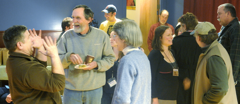 """FRESH DETAILS: Guests mingle Sunday before a screening of a documentary film called """"Fresh"""" at Johnson Hall Performing Arts Center in Gardiner. The event was sponsored by the Gardiner Food Co-Op and Cafe."""