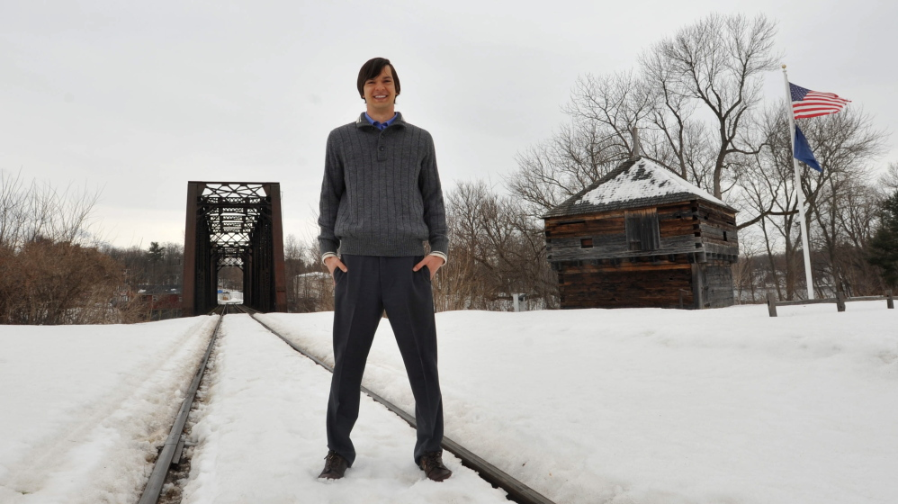BIT OF HISTORY: Colby College history professor Daniel Tortora, 32, stands at Fort Halifax Park Friday afternoon with the reconstructed blockhouse behind him. Tortora recently completed a book detailing the history of Fort Halifax that will be released on Tuesday.