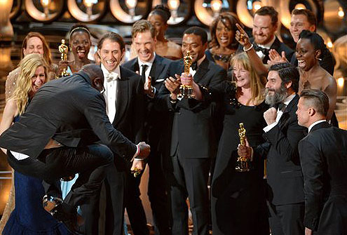 Director Steve McQueen, left, celebrates with the cast and crew of