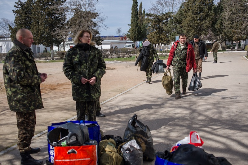 Ukrainian servicemen pile up their things after leaving the Ukrainian navy headquarters stormed by Crimean pro-Russian self-defense forces in Sevastopol, Crimea, on Wednesday. Crimea's self-defense forces on Wednesday stormed the Ukrainian navy headquarters in the Black Sea port of Sevastopol, taking possession without resistance a day after Russia signed a treaty with local authorities to annex the region.