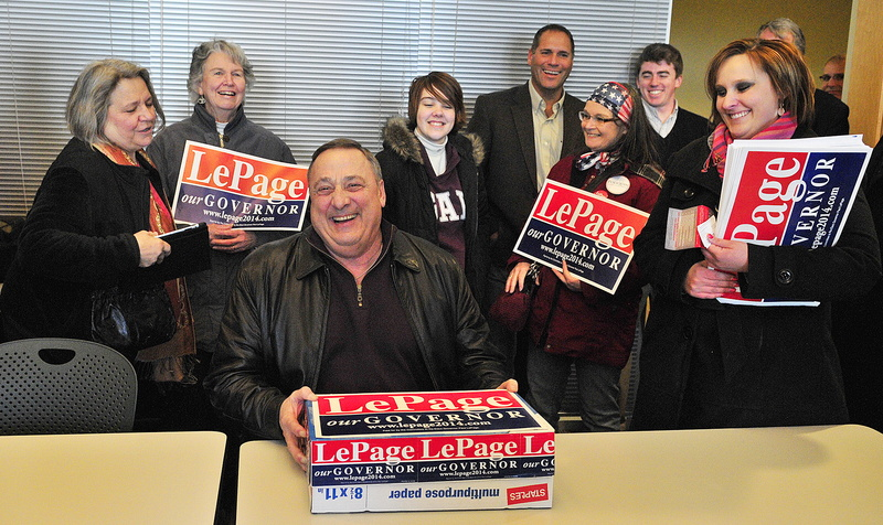 Gov. Paul LePage laughs with supporters as he delivers a box of petitions to get his name on the November ballot, at the Secretary of State's office Friday in the Cross State Office Building in Augusta.