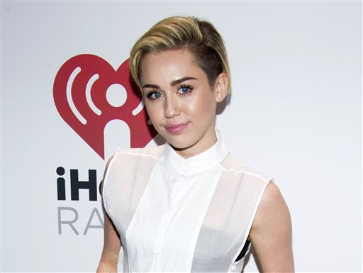 Miley Cyrus appears at the Z100's Jingle Ball in New York in this Dec. 13, 2013, photo.
