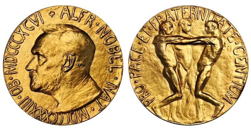 This undated photo provided by Stack's Bowers Galleries shows both sides of a Nobel Peace Prize that was saved from possible destruction for the value of its gold. The 1936 medal is only the second Nobel Peace Prize to come to auction and marked the first time an individual from Latin America was recognized by the prestigious award. The 23-karat relic is being offered for sale in Baltimore on March 27, 2014, by the New York-based Stack's Bowers Galleries.