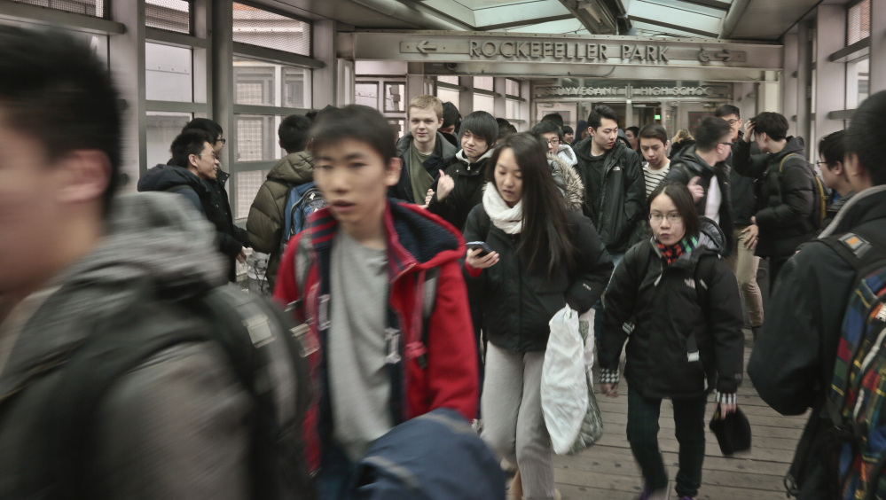In this March 25, 2014, students leave Stuyvesant High School in New York City. Asian children have the best chance of success based on an index that incorporates reading and math proficiency, high school graduation data, teen birthrates, employment prospects, family income and education levels, and neighborhood poverty levels.