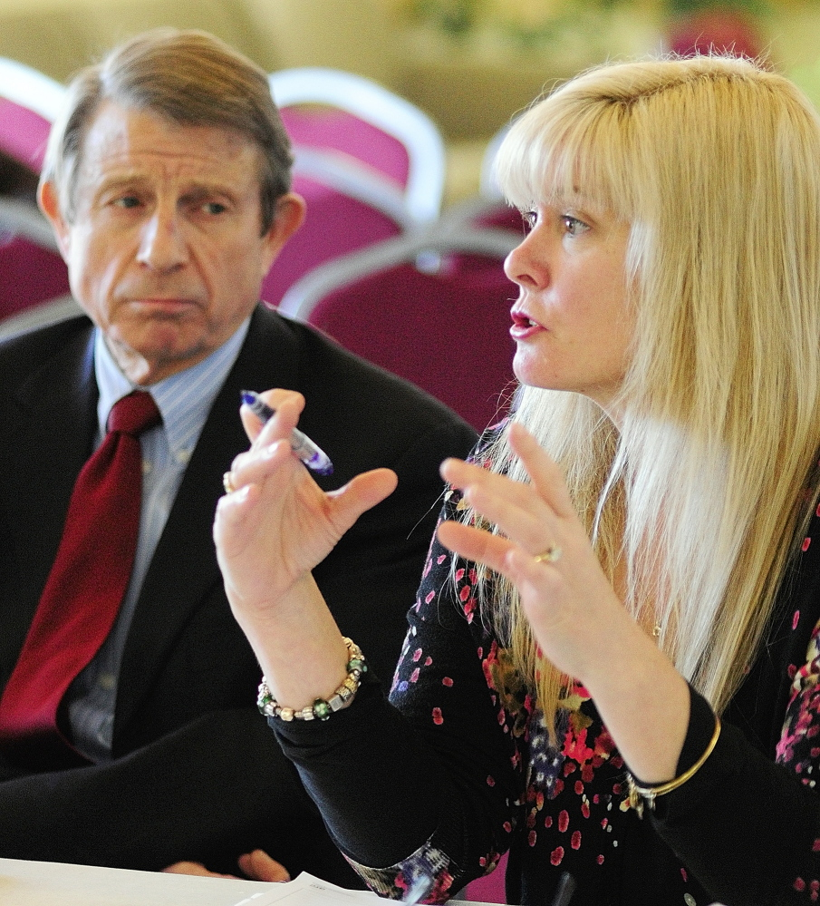 VIRTUALLY UNASSURED: Maine Virtual Academy board secretary Peter Mills, left, listens as board chairwoman Amy Carlisle answers a question from the state Charter School Commission in February during an in-depth interview at University of Maine at Augusta.