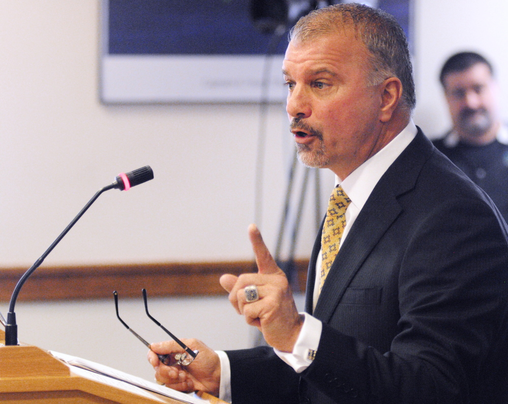 Claims unfairness: Kevin Cormier, vice president of Funtown Splashtown USA in Saco, testifies Tuesday against a bill that would remove some highway signs, in Augusta. Cormier said Funtown would lose its sign while ski areas would keep theirs.