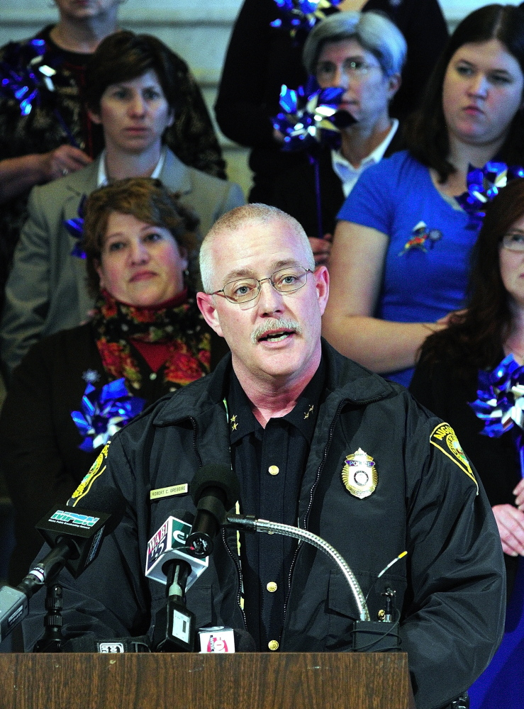 OUNCE OF PREVENTION: Augusta Police Chief Robert Gregoire speaks during a news conference held Tuesday in the State House Hall of Flags to kick off Child Abuse Prevention Month.