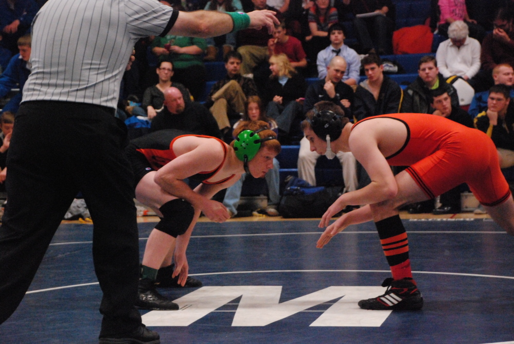 GOOD DAY: Peter Del Gallo, left, wrestles Tyler Craig, of Skowhegan, at a match earlier this season. Del Gallo capped a standout season by finishing third at nationals in the 113-pound weight class last weekend at Virginia Beach.