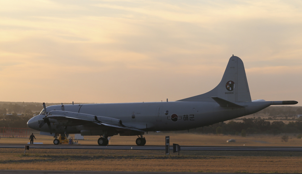A South Korean Navy P-3 Orion sits on the runway after returning from a search operation for the missing Malaysia Airlines Flight MH370, at Royal Australian Air Force base Peace in Perth, Australia, Thursday, April 3, 2014. The search operation continues but no trace of the Boeing 777 has been found nearly a month after it vanished in the early hours of March 8 on a flight from Kuala Lumpur to Beijing with 239 people on board.