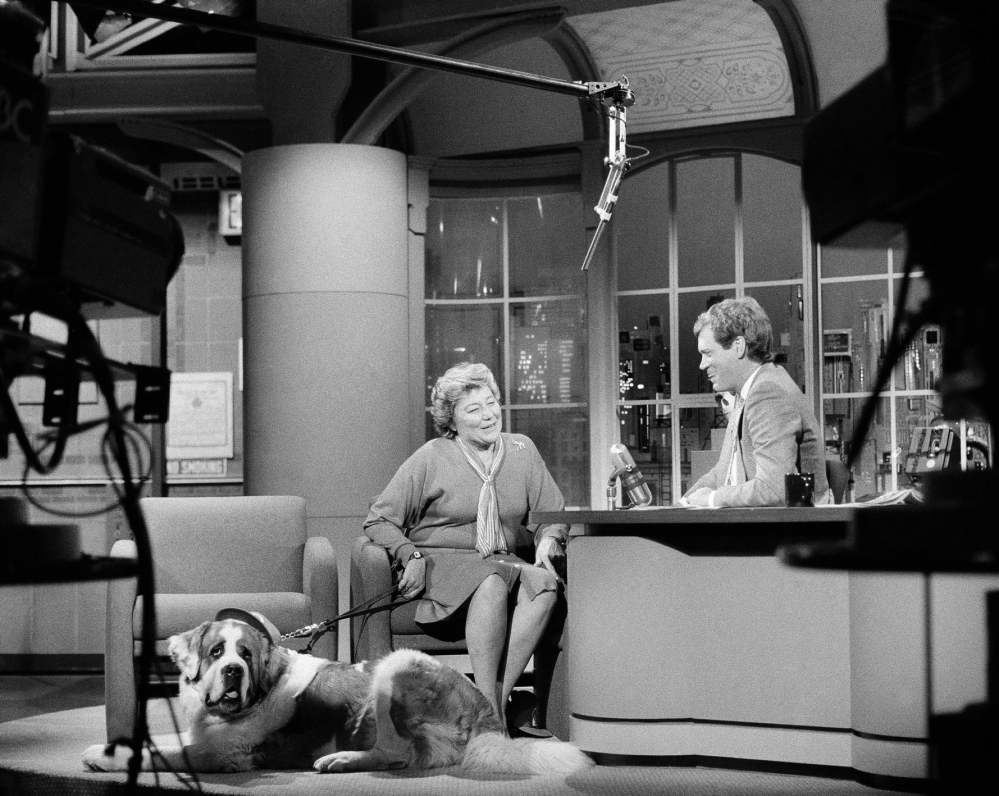 """Marge Schott, owner of the Cincinatti Reds, and her dog Schotzy appear on """"Late Night With David Letterman,"""" during a taping of the show, May 13, 1986."""
