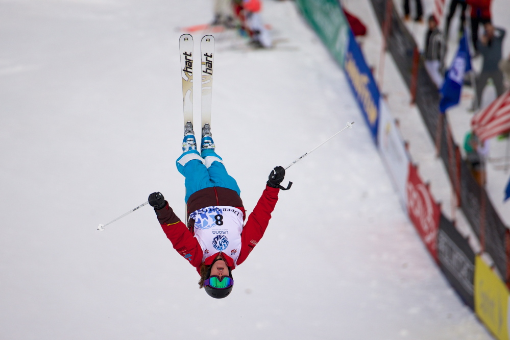 FLYING HIGH: Alex Jenson, 19, of Waterville competes in the Moguls competition at the 2014 US Freestyle National Championships.