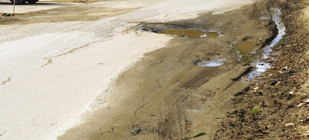 BAD ROADS: Sparrow Drive in the Riverside Drive Village on Thursday in Augusta.