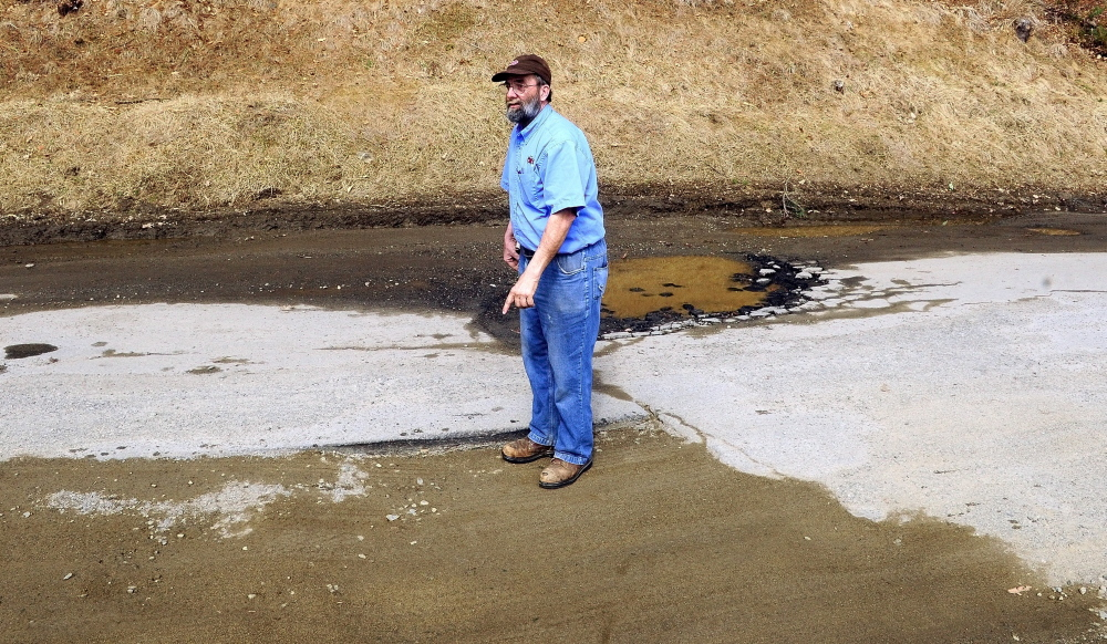 BAD ROADS: Bill Marson talks about the rough condition of Sparrow Drive in the Riverside Drive Village on Thursday in Augusta.