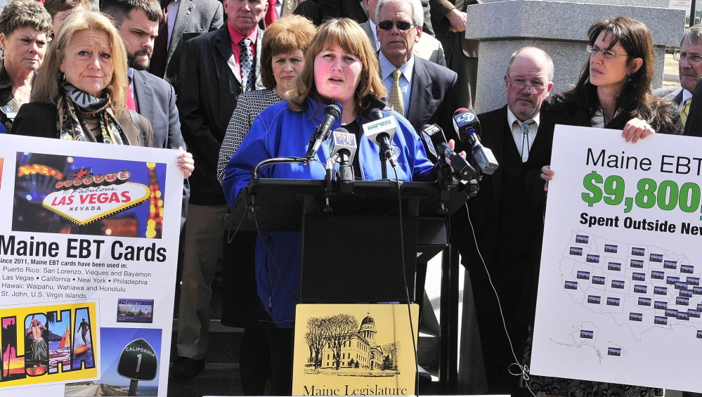 Rep. Sharri MacDonald, R-Old Orchard Beach, stands with fellow Republican legislators during a news conference on welfare reform bills on Friday at the State House.