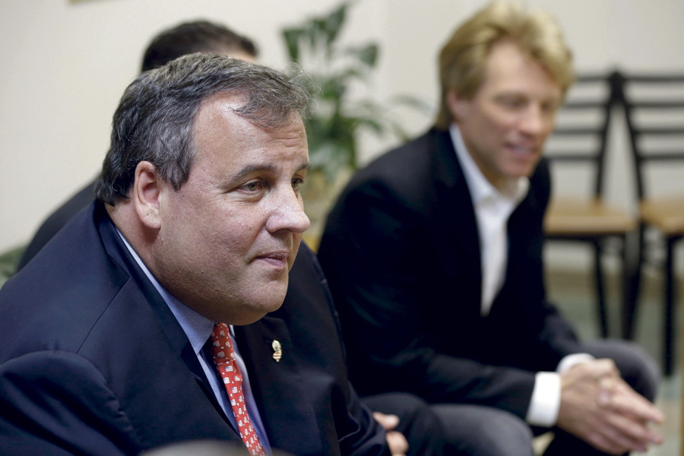 SAVING LIVES: New Jersey Gov. Chris Christie, left, sits with singer Jon Bon Jovi, right, while visiting patients at the Turning Point drug rehab program at Barnert Medical Arts Complex in Paterson, N.J., on May 2, 2013.